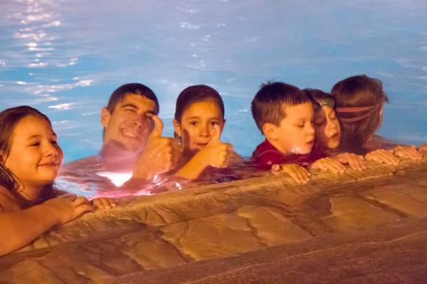 Kids and their parents were invited to take part in the cannonball contest during the New Year's Eve celebration at Glenwood Springs' fabled Hot Springs Pool.