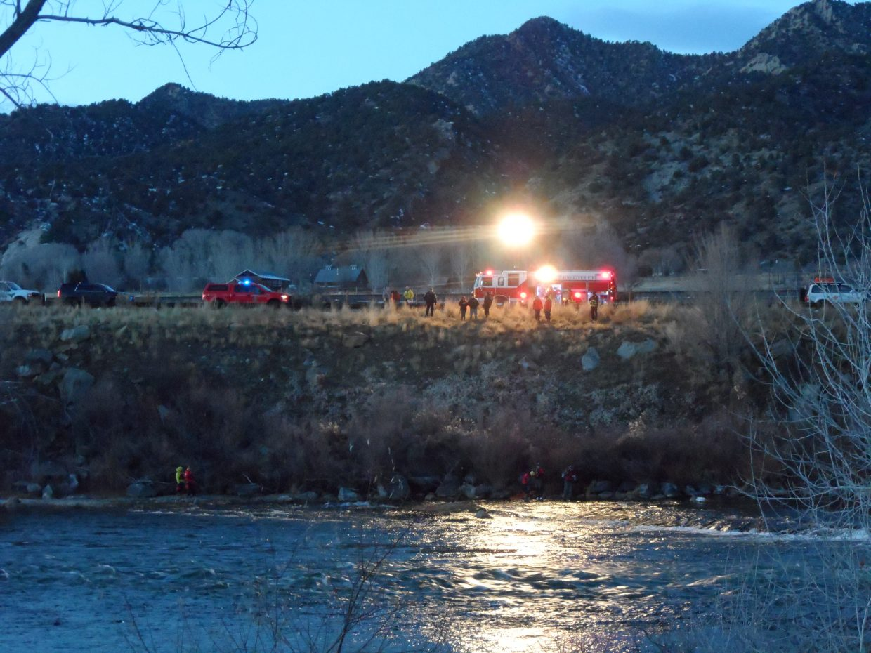 Crews work Saturday to recover a body from the Colorado River.