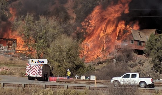 Flames jump from one house to another south of Glenwood Springs in November.