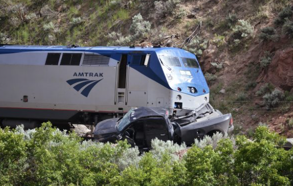 A pickup truck sits after being dragged by an Amtrak train west of Glenwood on May 31.