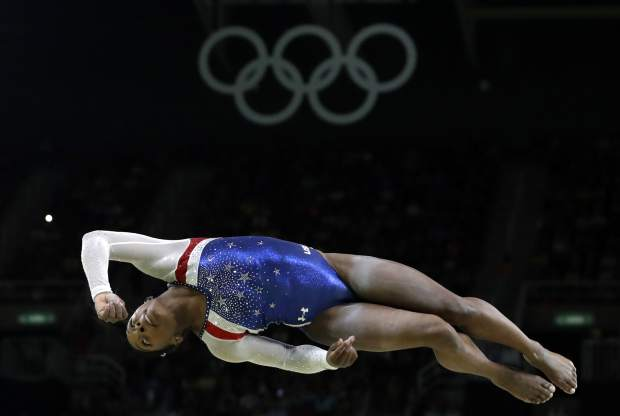 FILE - In this Aug. 11, 2016, file photo, United States' Simone Biles performs on the balance beam during the artistic gymnastics women's individual all-around final at the 2016 Summer Olympics in Rio de Janeiro, Brazil. Briles was selected as the AP Female Athlete of the Year, on Monday, Dec. 26, 2016. (AP Photo/Rebecca Blackwell, File)