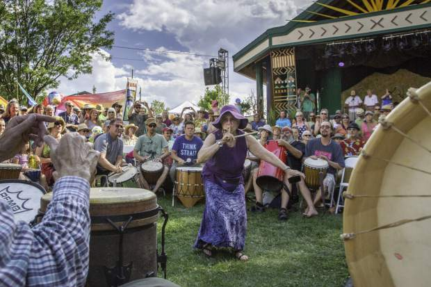 Laurie Loeb lead the roughly 300 members of the Rythems of the Heart Community Drum during the first night of the 45th Annual Carbondale Mountain Fair in July.