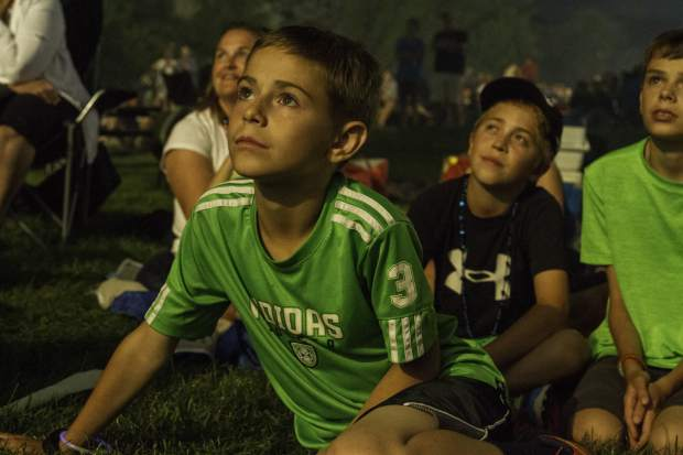 10-year-old Keenen Coe and friends watched the fireworks display at Two Rivers Park during the Fourth of July Celebration.
