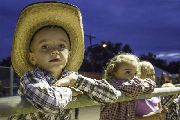 Seven-year old Deakon Parchman of Parachute, CO spent the evening at the Garfield County Fair and Rodeo in Rifle - watching cowboys ride the bucking broncos and many wild events in August.