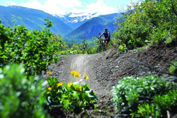 A cyclist makes his way up the Airline Trail at Sky Mountain Park. Pitkin County is fortunate that it has a successful Open Space and Trails Program. If there is a movement in the federal government to transfer public land to the states, Pitkin County's holdings would be exempt.