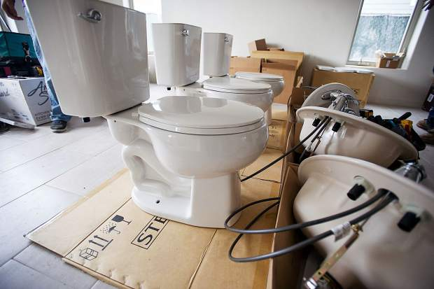 New toilets are ready to be installed at Jamie Wilson's new Habitat for Humanity home in Carbondale.