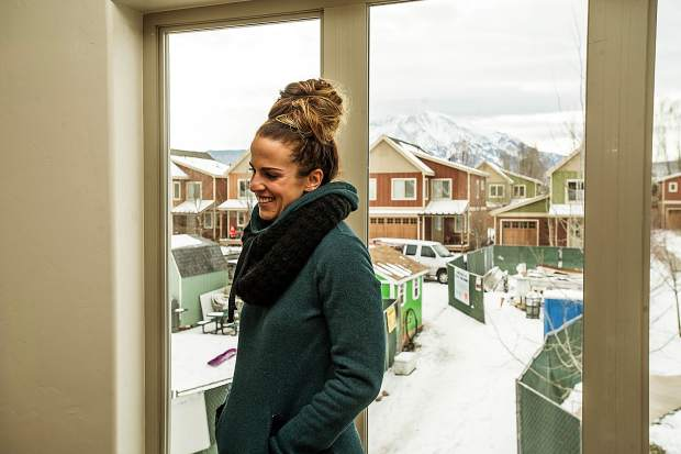 Jamie Wilson stands in her future bedroom in her Habitat for Humanity home in Carbondale on Wednesday. The south-facing room provides drop-dead gorgeous views of Mount Sopris.