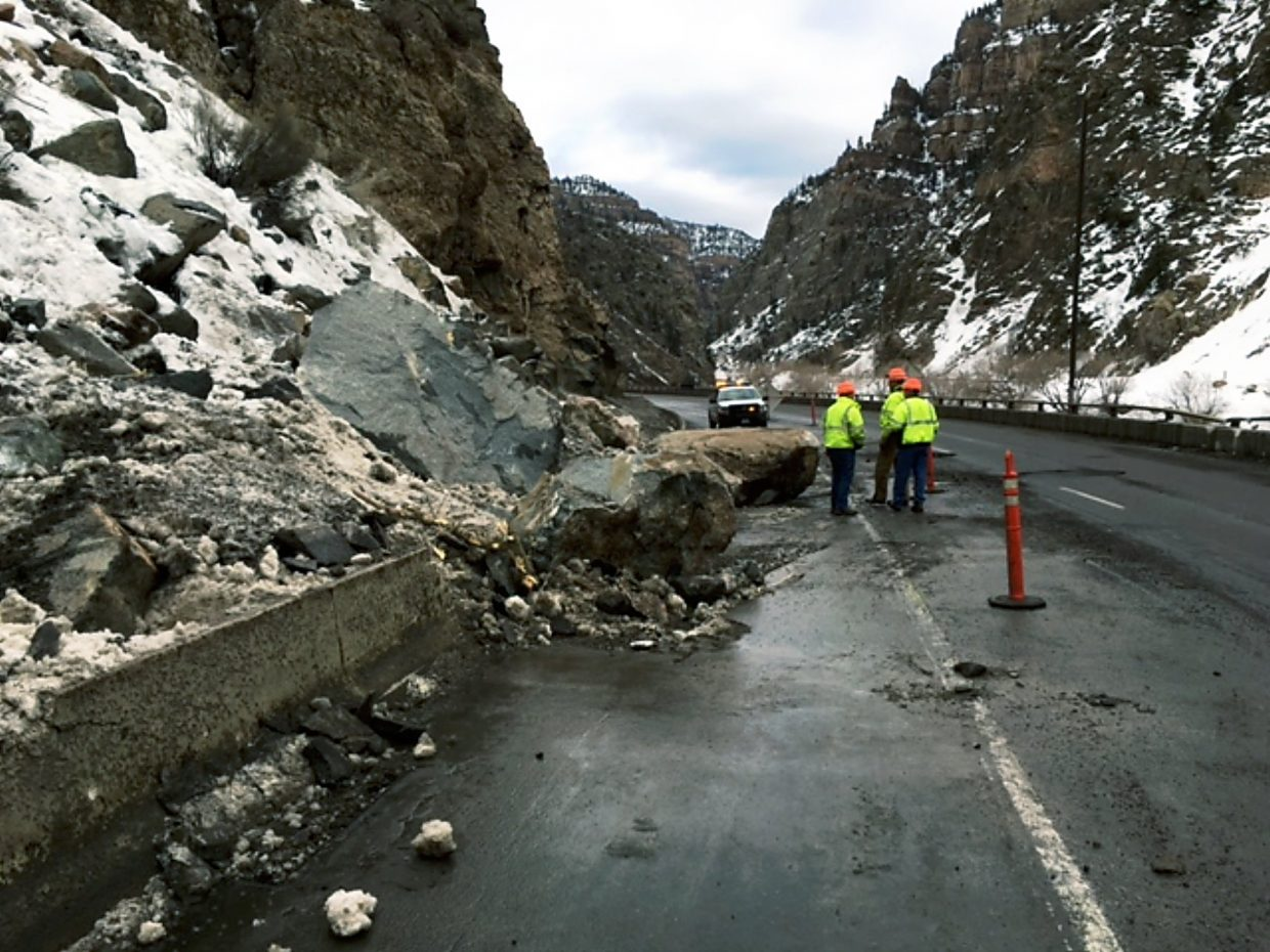 Workers assess rockfall last month in Glenwood Canyon.
