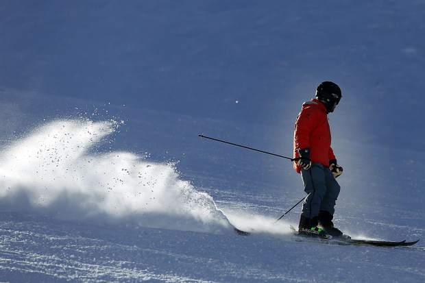 A skier takes to the slopes at Aspen Mountain on Tuesday. When ski areas generate more revenue from national forest lands used in ski operations, they pay a higher fee to the federal government.