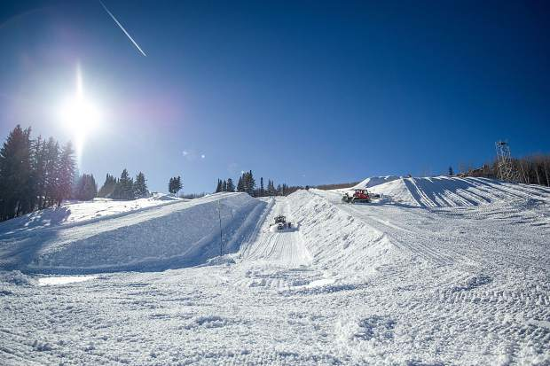 Snowcats prowl the base of Buttermilk Tuesday to prepare the super pipe and the massive jump used for the Winter X Games.