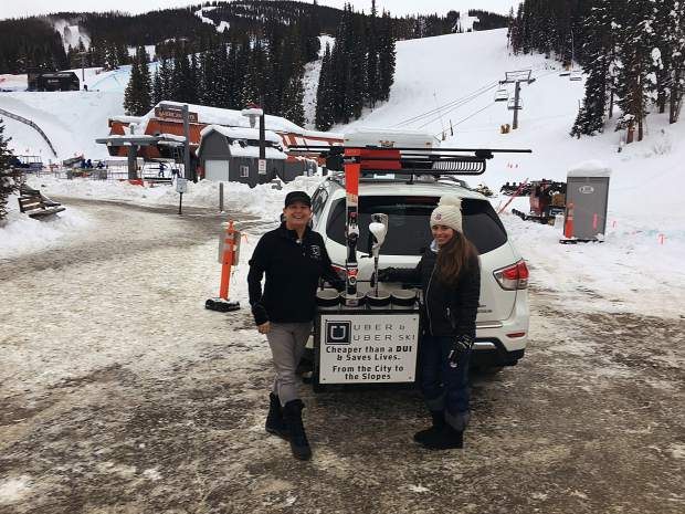 Local Uber driver Gail McManus (left) and her carwith the new uberSKI rack. The new service allows skiers and snowboarders like Lacie Greenwald (right) to head straight to the slopes. Greenwald is a professional skier that trains at Copper Mountain.
