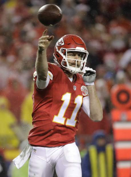 Kansas City Chiefs quarterback Alex Smith throws during the first half of an NFL football game against the Denver Broncos in Kansas City, Mo., Sunday, Dec. 25, 2016. (AP Photo/Charlie Riedel)