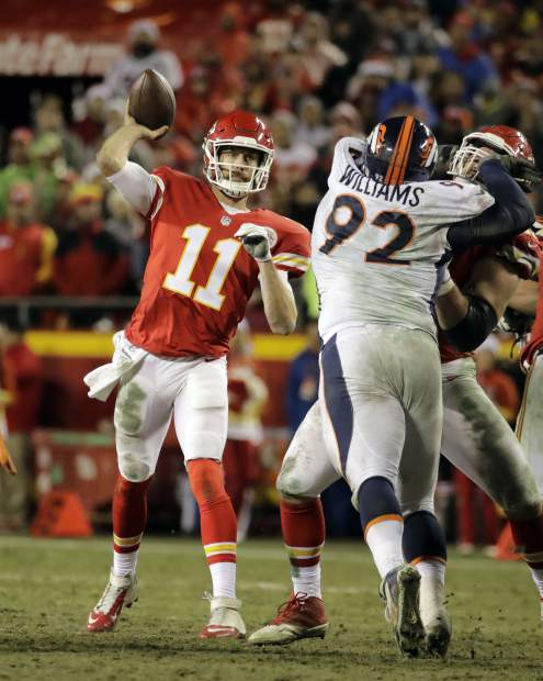 Kansas City Chiefs quarterback Alex Smith (11) throws as Denver Broncos linebacker Todd Davis (51) closes in, during the second half of an NFL football game in Kansas City, Mo., Sunday, Dec. 25, 2016. (AP Photo/Charlie Riedel)