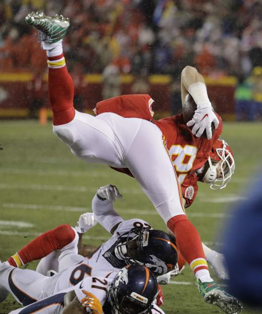 Kansas City Chiefs tight end Travis Kelce (87) jumps over Denver Broncos cornerback Aqib Talib (21) and safety Darian Stewart (26) during the first half of an NFL football game in Kansas City, Mo., Sunday, Dec. 25, 2016. (AP Photo/Charlie Riedel)