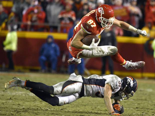 Kansas City Chiefs tight end Travis Kelce (87) vaults Denver Broncos safety Justin Simmons (31) during the second half of an NFL football game in Kansas City, Mo., Sunday, Dec. 25, 2016. (AP Photo/Ed Zurga)