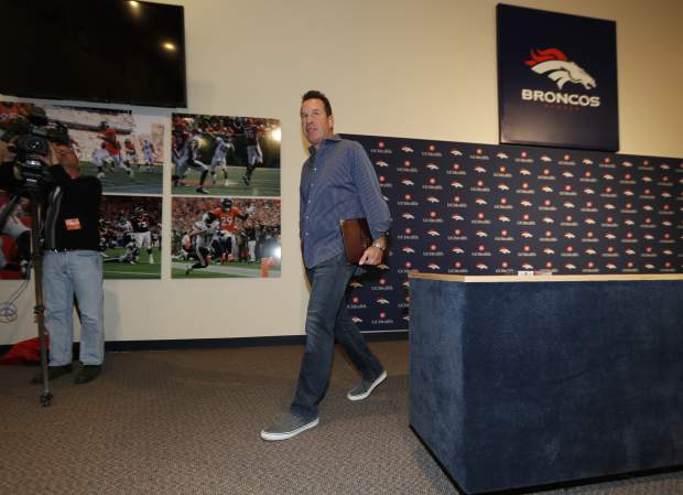 Gary Kubiak walks away after he stepped down as head coach of the Denver Broncos because of health concerns Monday, Jan. 2, 2017, at team headquarters in Englewood, Colo. (AP Photo/David Zalubowski)