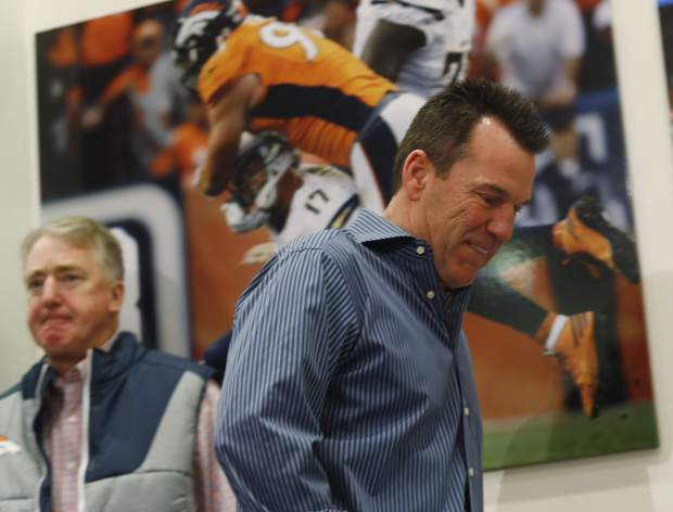 Gary Kubiak, front, heads to the podium to step down as head coach of the Denver Broncos because of health concerns on Monday at team headquarters in Englewood. Joe Ellis, team chief executive officer and president, left, looks on.