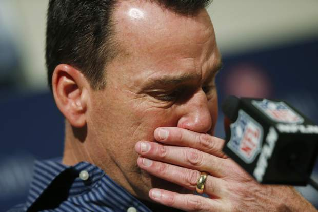 Gary Kubiak reacts at a news conference as he steps down as head coach of the Denver Broncos because of health concerns Monday, Jan. 2, 2017, at team headquarters in Englewood, Colo. (AP Photo/David Zalubowski)