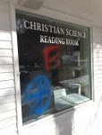 More graffiti on the window at the Christian Science Reading Room at 10th and Cooper.
