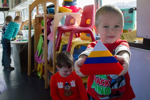 Keagan Baker shows off the pyramid he built during his morning preschool class on Gus the Bus, which is in its sixth year.