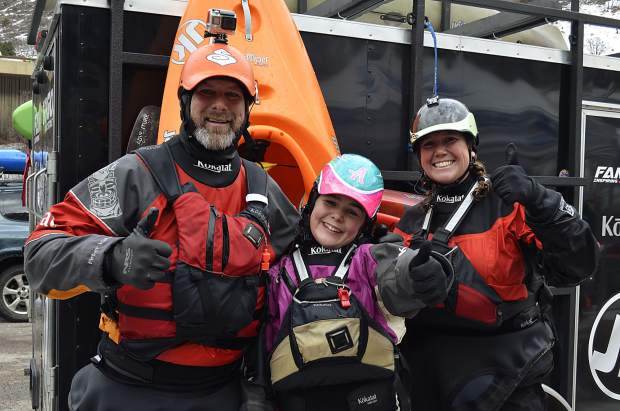 The Holcombes, a kayaking family that's taken their outdoor passions on a permanent road trip, joined dozens of other hardcore boaters on a New Year's Day run on Shoshone. From left, Peter, Abby and Kathy Holcombe.