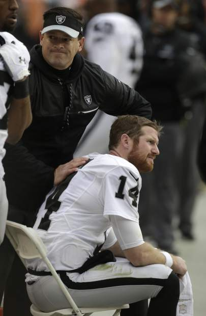Oakland Raiders quarterback Matt McGloin is tended to on the sideline after an injury during the first half of the team's NFL football game against the Denver Broncos, Sunday, Jan. 1, 2017, in Denver. (AP Photo/Joe Mahoney)