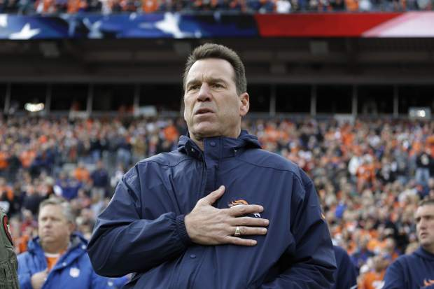 Denver Broncos coach Gary Kubiak stands during the singing of the national anthem before the team's NFL football game against the Oakland Raiders, Sunday, Jan. 1, 2017, in Denver. (AP Photo/Jack Dempsey)