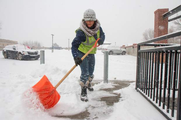 Staci Andrassy is part of the small fleet of  Glenwood workers who spend long hours outside working to clear the sidewalks and walkways around town.