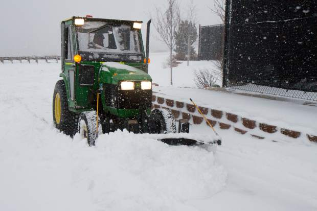Glenwood Springs workers toil to keep up with clearing the sidewalks.
