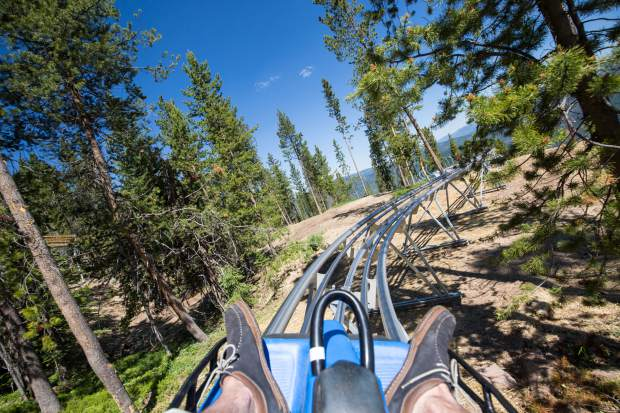 A rider coasts through the trees on Vail Mountain's Forest Flyer alpine coaster this summer. Aspen Skiing Co. has proposed a similar coaster at Snowmass.