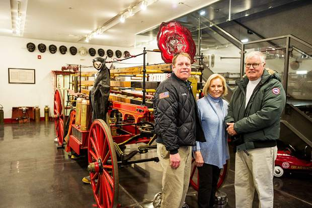 Brentley Childs, left, mother Lee and father Walton pose at the Aspen firehouse Wednesday evening.