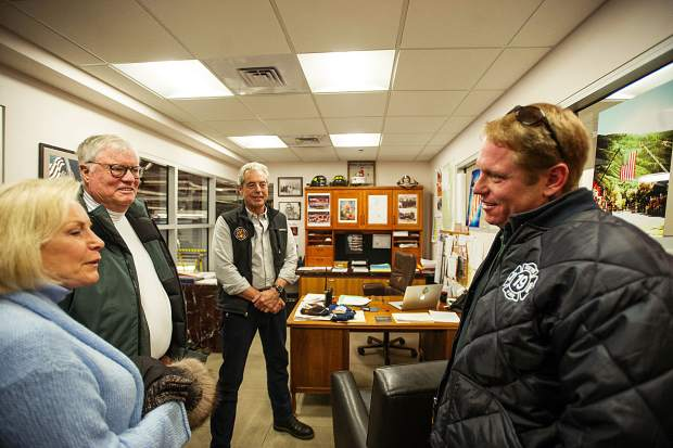 Walton Childs, center, and his wife Lee and son Brentley, right, relive the day of his stroke in Aspen 22 years ago by retelling it to Aspen Fire Chief Rick Balentine on Wednesday.