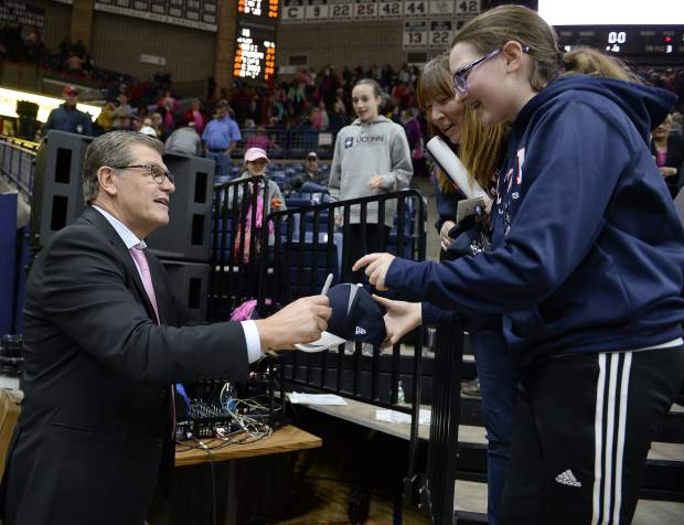 Connecticut head coach Geno Auriemma signs autographs for fans after an NCAA college basketball game against SMU, Saturday, Feb. 11, 2017, in Storrs, Conn. UConn extended its NCAA record winning streak to 99 games with an 83-41 win. (AP Photo/Jessica Hill)