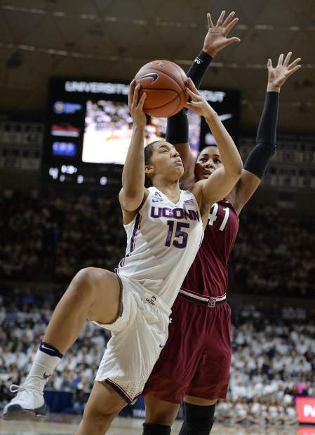Connecticut's Gabby Williams shoots as South Carolina's Alaina Coates, right, defends, in the first half of an NCAA college basketball game, Monday, Feb. 13, 2017, in Storrs, Conn. (AP Photo/Jessica Hill)