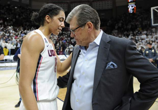 Connecticut head coach Geno Auriemma takes a moment with player Gabby Williams at the end of an NCAA college basketball game against South Carolina, Monday, Feb. 13, 2017, in Storrs, Conn. Williams had 26 points in UConn's 100th win, beating South Carolina, 66-55. (AP Photo/Jessica Hill)