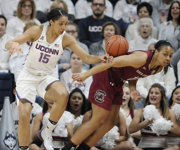 Connecticut's Gabby Williams, left, and South Carolina's Allisha Gray, right, go for a rebound in the first half of an NCAA college basketball game, Monday, Feb. 13, 2017, in Storrs, Conn. (AP Photo/Jessica Hill)