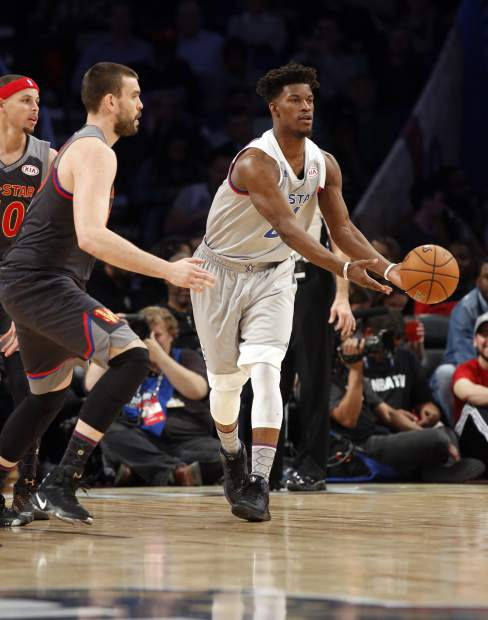 Eastern Conference small forward Jimmy Butler of the Chicago Bulls passes the ball during the second half of the NBA All-Star basketball game in New Orleans, Sunday, Feb. 19, 2017. (AP Photo/Max Becherer)