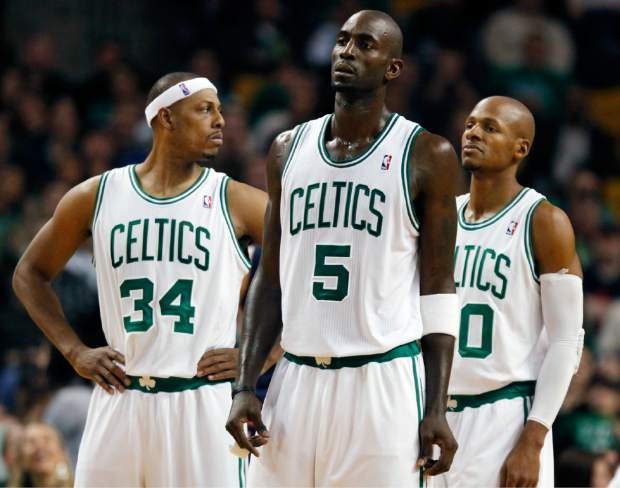 FILE - In this Jan. 6, 2012, file photo, Boston Celtics' Paul Pierce (34), Kevin Garnett (5) and Ray Allen (20) wait for play to resume after a timeout in the fourth quarter of an NBA basketball game against the Indiana Pacers in Boston. There have been superteams that found winning formulas before, like Boston when Allen and Garnett joined Pierce. (AP Photo/Michael Dwyer, File)