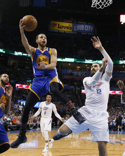 Golden State Warriors guard Stephen Curry (30) shoots next to Oklahoma City Thunder center Steven Adams (12) during the third quarter of an NBA basketball game in Oklahoma City, Saturday, Feb. 11, 2017. Golden State won 130-114. (AP Photo/Sue Ogrocki)