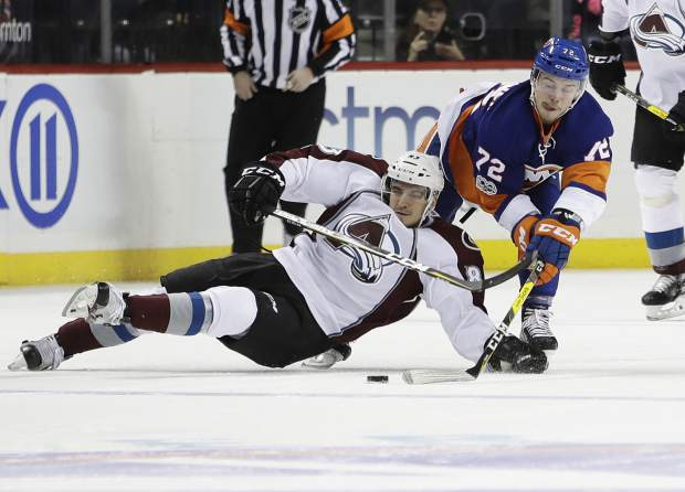 New York Islanders' Anthony Beauvillier (72) fights for control of the puck with Colorado Avalanche's Joe Colborne (8) during the first period of an NHL hockey game, Sunday, Feb. 12, 2017, in New York. (AP Photo/Frank Franklin II)