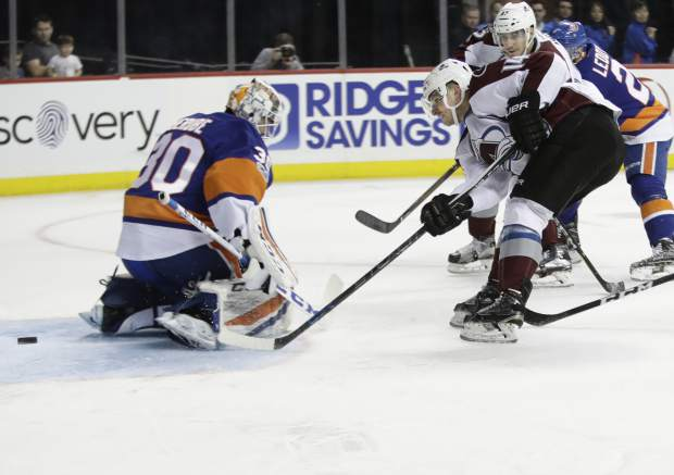 Colorado Avalanche's Blake Comeau (14) attempts to score on New York Islanders goalie Jean-Francois Berube (30) during the first period of an NHL hockey game, Sunday, Feb. 12, 2017, in New York. (AP Photo/Frank Franklin II)