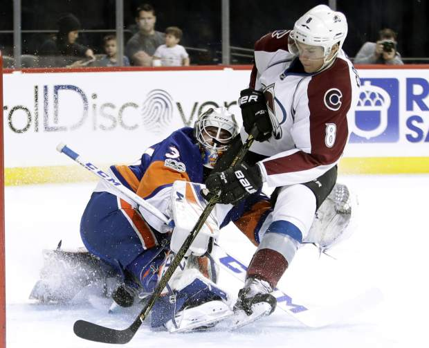 Colorado Avalanche's Joe Colborne (8) shoots the puck past New York Islanders goalie Jean-Francois Berube (30) for a goal during the first period of an NHL hockey game Sunday, Feb. 12, 2017, in New York. (AP Photo/Frank Franklin II)