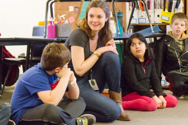 Anastasia Davidson interacts with fourth graders at Glenwood Springs Elementary School during a Colorado Shakespeare Festival workshop. The workshop used role playing exercises to help students understand how they might feel if they were bullied. They then learned about ways to intervene when they see someone in that situation.