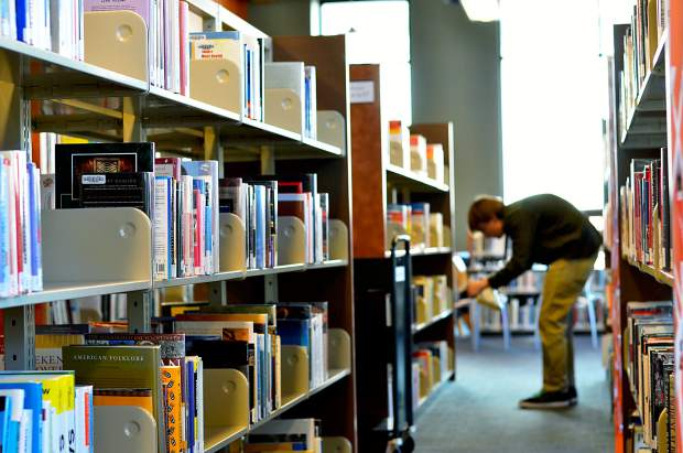 A library patron browses the stacks at the Glenwood Springs Branch Library recently.