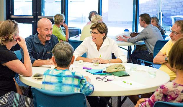 Participants in Tuesday's Glenwood Springs Library communitiy input meeting take part in a small group discussion to share their ideas for the Garfield County Public Library District's strategic planning process.