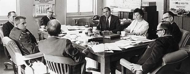 "This is the first or second Colorado Mountain College Governing Board meeting on Jan. 7, 1966, two months after the college district was established. Shown are David Delaplane at the far end of the table (wearing glasses), then counterclockwise: Howard Clark (Summit County), David Barbee (Pitkin County), Dr. Lucksinger (Colorado Department of Education), Pat Harvey (Lake County), Bill Stevens (Colorado Commission on Higher Education), Josephine ""Jody"" Busby (Garfield County clerk who certified the votes) and Harold Koonce (Eagle County), who was selected as first board president."