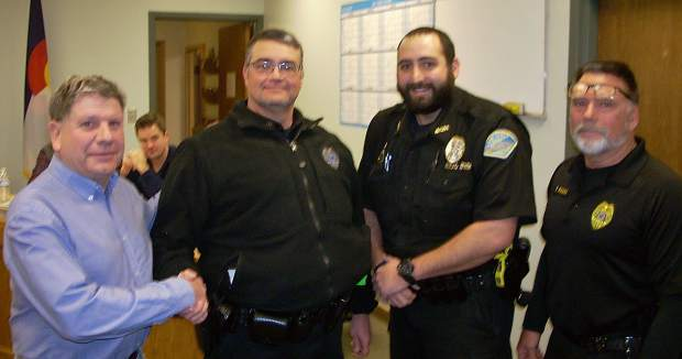At the town of New Castle's Council meeting on Jan. 17, police officer Chuck Burrows received the Medal of Valor in the Line of Duty. From left is Mayor Art Riddile, Police Officer Chuck Burrows, Police Officer Brian Dominguez and Police Chief Tony Pagni.