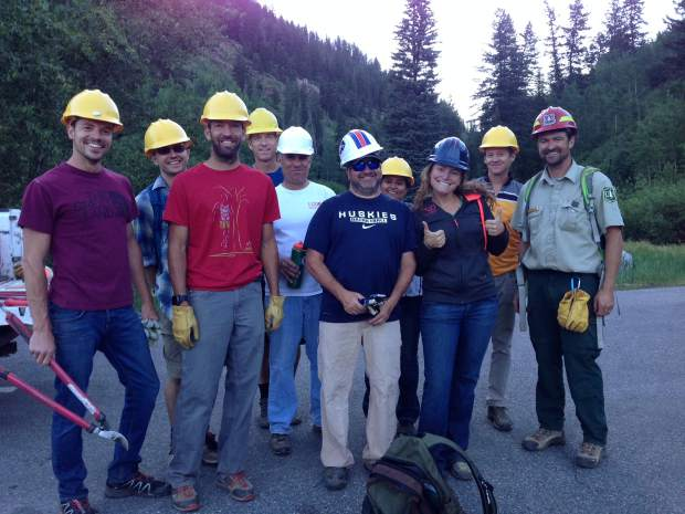 A volunteer group from the Adopt a Trail program takes a break from trail work.