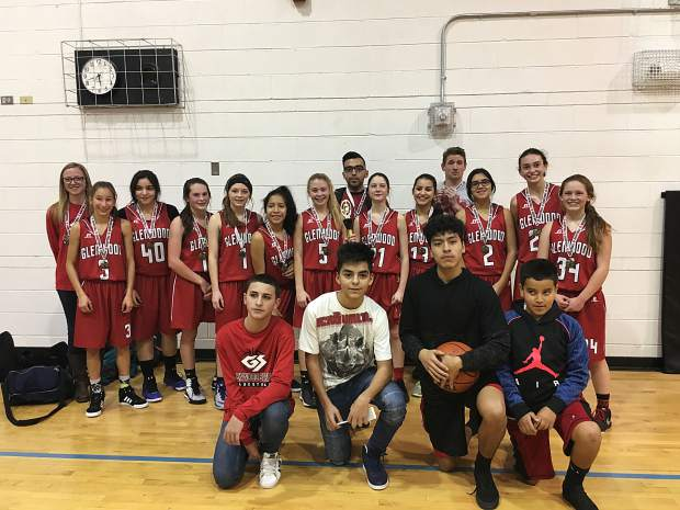 The Glenwood Demons eighth-grade girls basketball team celebrates a first place finish at the Eagle Valley tournament back in January.