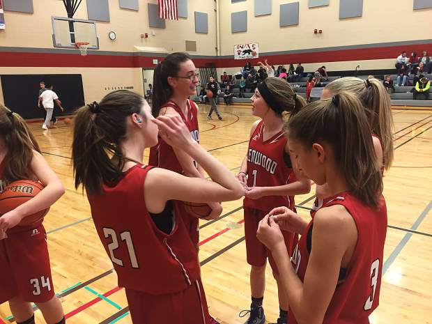 Members of the Glenwood Demons eighth-grade girls basketball team puts ear plugs in prior to tip-off of a road game at Grand Valley last week.